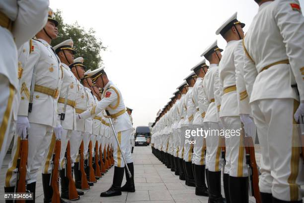 Honour guards prepare for US President Donald Trump's welcoming ceremony at the Great Hall of the People on November 9 2017 in Beijing China Trump is...