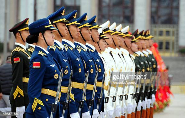 Honour guards stand in attention during the commemoration ceremony for the first Martyrs' Day at the People's Heroes Monument in Beijing's Tiananmen...
