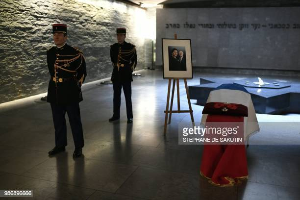 Honour guards stand next to the coffins of women's rights icon French politician and Holocaust survivor Simone and her husband Antoine Veil drapped...
