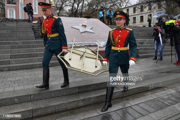 Honour guards walk away after a wreath-laying ceremony by North Korean leader was cancelled, at a WWII memorial in the far-eastern Russian port of...