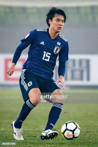 Honoya Shoji of Japan drives the ball during the AFC U23 Championship Group B match between Japan and North Korea at Jiangyin Stadium on January 16...