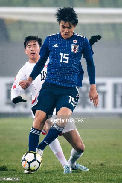 Honoya Shoji of Japan drives the ball during the AFC U23 Championship Group B match between Japan and North Korea at Jiangyin Stadium on January 16...