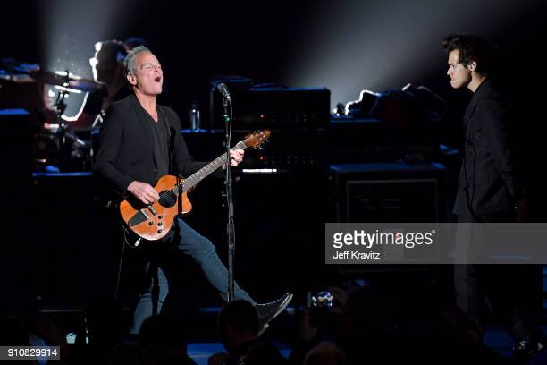 Honroee Lindsey Buckingham of music group Fleetwood Mac and recording artist Harry Styles perform onstage during MusiCares Person of the Year...