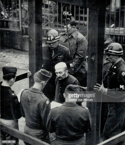 Hood and noose is placed over the head of a German civilian on the gallows at Bruchsal prison Germay for the murder of six American airmen shot down...
