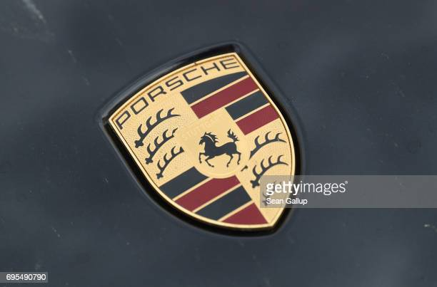 A hood ornament shows the Porsche logo on a Porsche Cayenne diesel SUV parked on June 13 2017 in Berlin Germany Spiegel magazine after conducting...