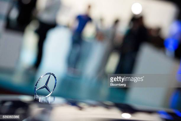 A hood ornament sits on a MercedesBenz E220 automobile during Daimler AG's TecDay Road to the Future event in Stuttgart Germany on Thursday June 9...