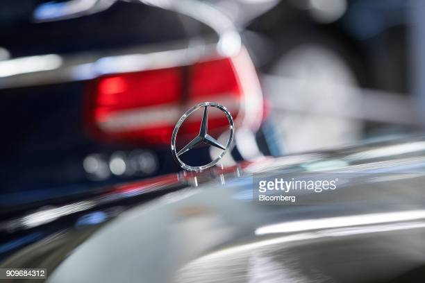 A hood ornament sits on a MercedesBenz SClass automobile on the final quality check line at the automaker's factory in Sindelfingen Germany on...