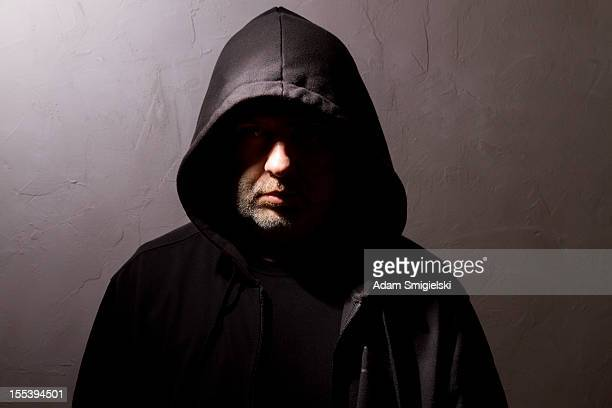 hooded man with hidden face - hooded top stock pictures, royalty-free photos & images