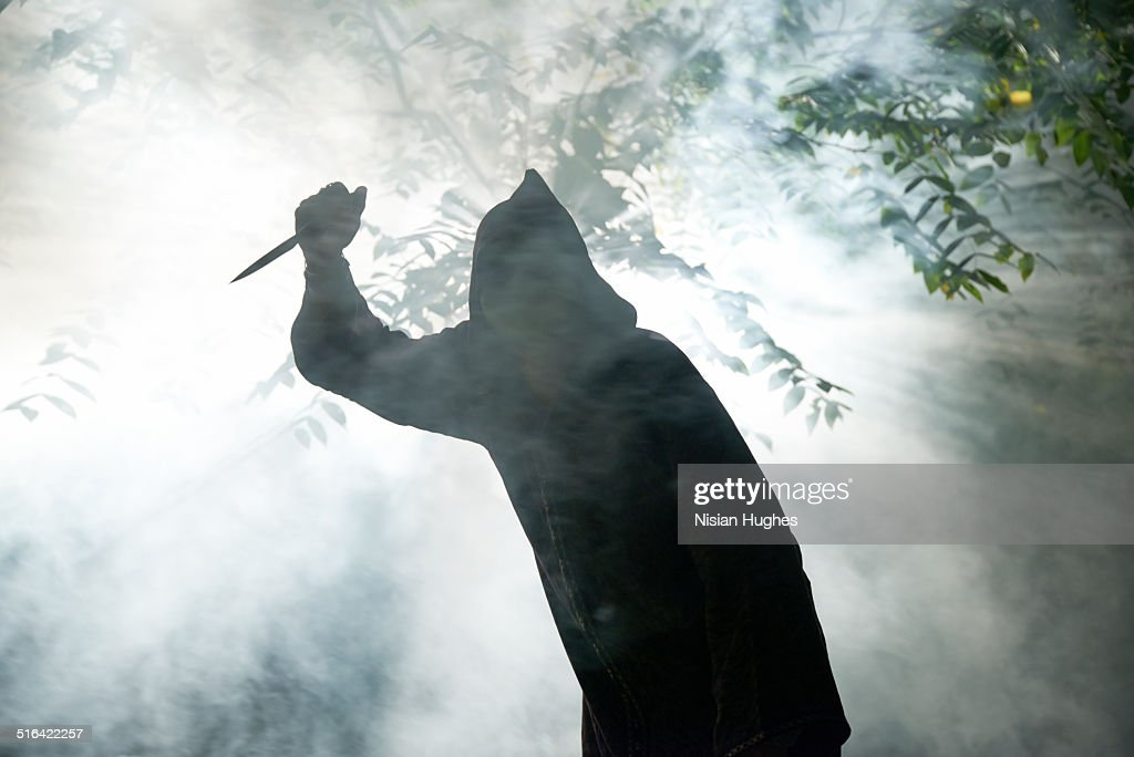 hooded monster with knife : Stock Photo