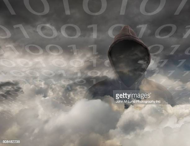 Hooded person with binary code in clouds
