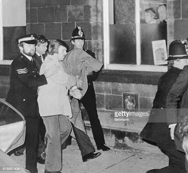 Hooded Peter Sutcliffe the man accused of the Ripper Murders, appears here, being escorted by police into the Dewsbery Court to be charged with...