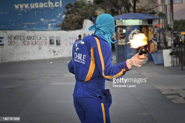CONTENT] Hooded throws molotov cocktail at police