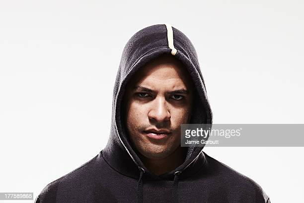 hooded young mixed race male - hooded shirt stock pictures, royalty-free photos & images