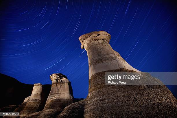 Hoodoos and star trails in the sky