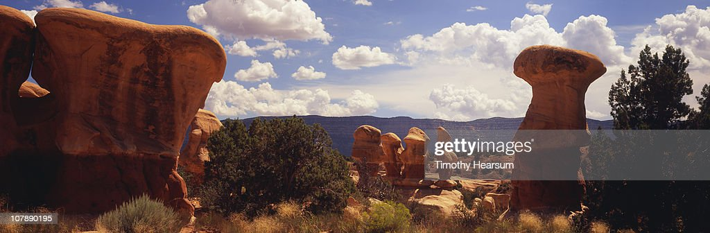 Hoodoos with mountains and sky beyond : Stock Photo