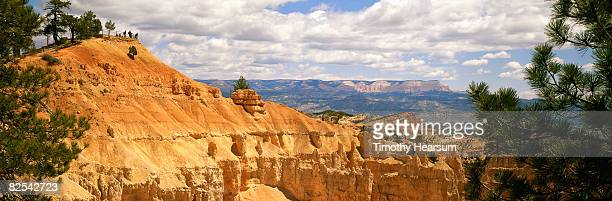 hoodoos with mountains in distance - timothy hearsum stock pictures, royalty-free photos & images