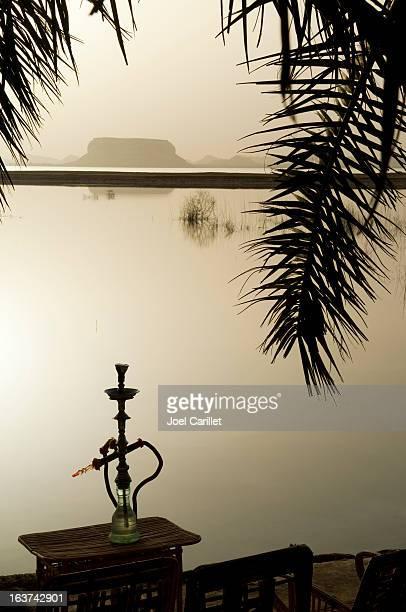 Hookah at sunset at Fatnas Spring, Siwa, Egypt