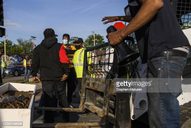 Hooker confronts City of Minneapolis workers as they remove planter boxes from George Floyd Square on June 3, 2021 in Minneapolis, Minnesota. Early...