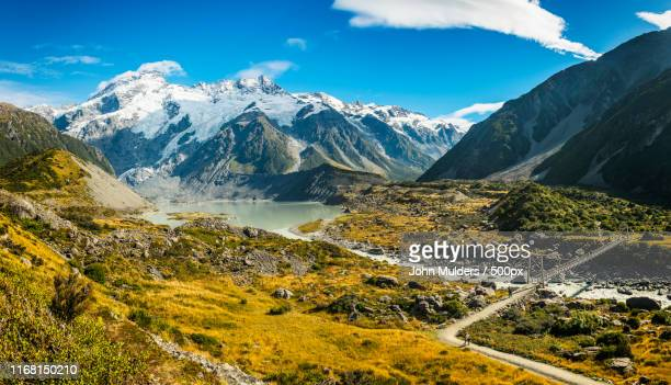 hooker valley track - snowcapped mountain stock pictures, royalty-free photos & images