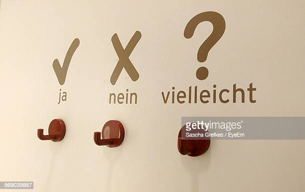 Hooks On Wall With Text