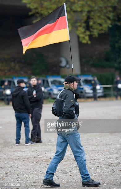 Hooligans against Salafists Nazi march at the Hogesademonstration in CologneHogesa protester with German flag
