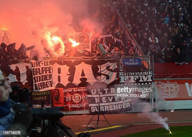 Hooligans burn flares during the German first division Bundesliga football match Bayer Leverkusen vs Eintracht Frankfurt in the German city of...