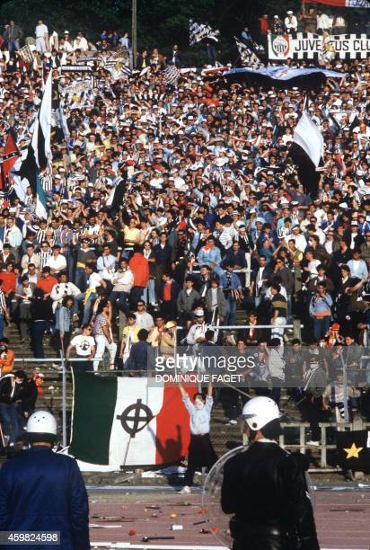 Hooligans face 29 May 1985 police forces at the scene of riots in Heysel football stadium in Brussels. Thirty-nine Juventus football fans died during...
