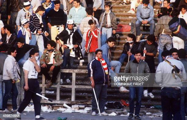 Hooligans face 29 May 1985 police forces at the scene of riots in Heysel football stadium in Brussels Thirtynine Juventus football fans died during...