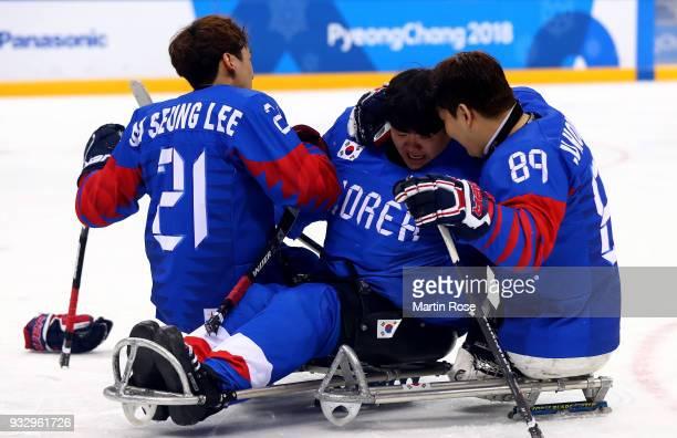 Hoon Ji Lee of Korea celebrate with team mate Woong Jae Lee after winning the bronze in the Ice Hockey bronze medal game between Korea and Italy...