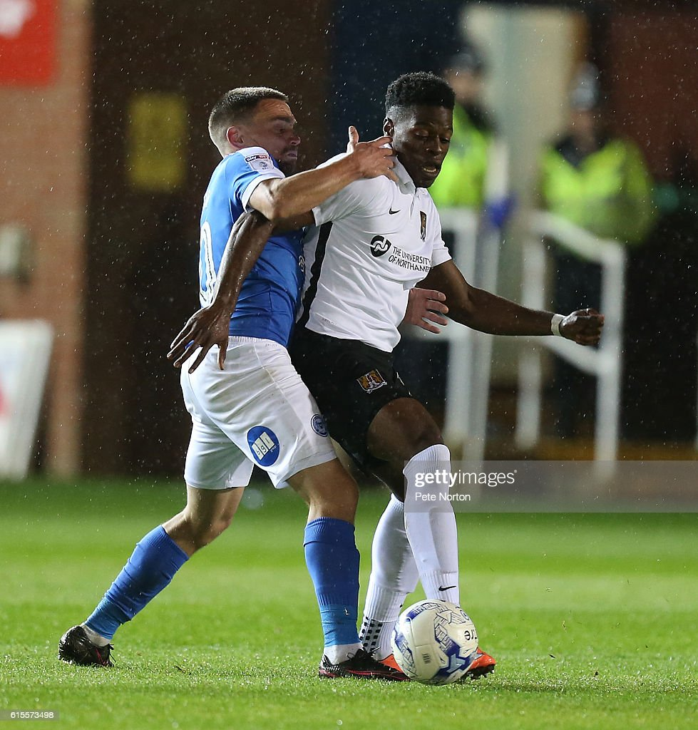 JJ Hooper of Northampton Town contests the ball with Paul Taylor of Peterborough United during the Sky Bet League One match between Peterborough United and Northampton Town at ABAX Stadium on October 18, 2016 in Peterborough, England.