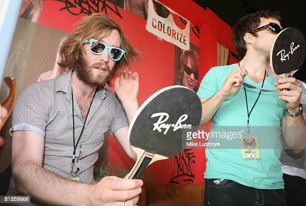 Hoosiers drummer Alphonso Sharland and band frontman Irwin Sparkes try on sunglasses before performing at the Isle of Wight Festival on June 13 2008...