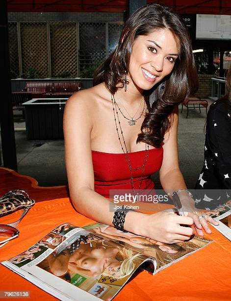 Hooter girl Kat Longa signs a copy of Playboy Magazine at Playboy Magazine's February 2008 Issue The Women of Hooters autograph signing February 7...