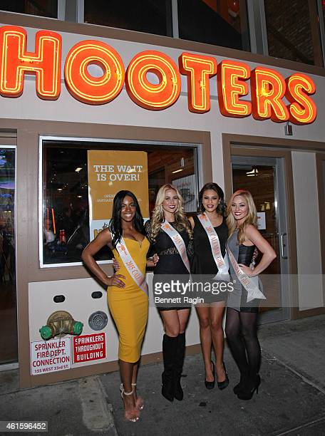 Hooters Calendar girls Alicia Williams, Emily Phelps, Nicole Osorio, and Ashley Dill attend Hooters Manhattan VIP Press Party at Hooters Manhattan on...