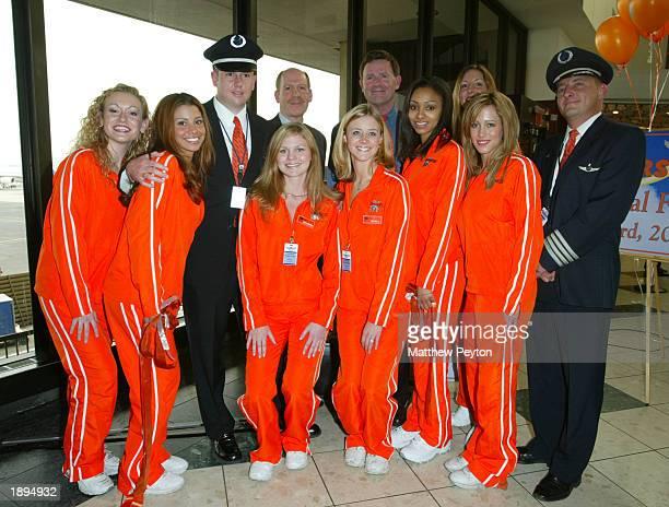 Hooters executives, Hooters airline pilots and Hooters Girls celebrate the inauguration of the airline's new service between Newark and Myrtle Beach,...