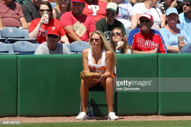 Hooters girl is waiting patiently for a foul ball to retrieve during the spring training game between the Pittsburgh Pirates and the Philadelphia...