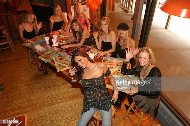 Hooters girls attend the Hooters girls calendar signing event at Hooters restaurant October 21, 2004 in New York City.