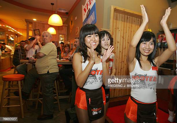 Hooters waitresses entertain the crowd at the opening of the US restaurant chain's first outlet in Beijing 10 September 2007 and fourth overall in...