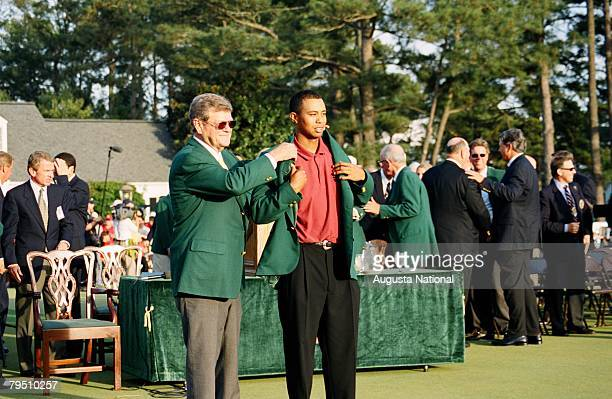 Hootie Johnson Presents The Green Jacket To Tiger Woods At The Presentation Ceremony Of The 2002 Masters Tournament