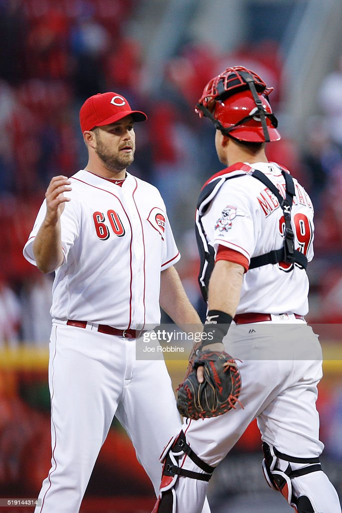 J.J. Hoover #60 and Devin Mesoraco #39 of the Cincinnati Reds celebrate after the final out of the opening day game against the Philadelphia Phillies at Great American Ball Park on April 4, 2016 in Cincinnati, Ohio. The Reds defeated the Phillies 6-2.