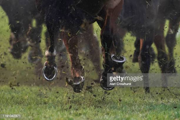 Hooves and mud as the runners in The Get Your Ladbrokes 1 Free Bet Today Handicap Hurdle turn into the back straight at Newbury Racecourse on...