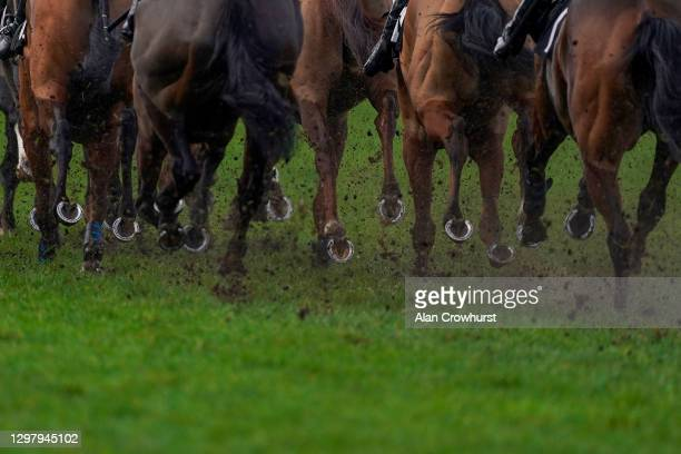 Hooves and mud at Ascot Racecourse on January 23, 2021 in Ascot, England. Due to the Coronavirus pandemic, owners along with the paying public will...