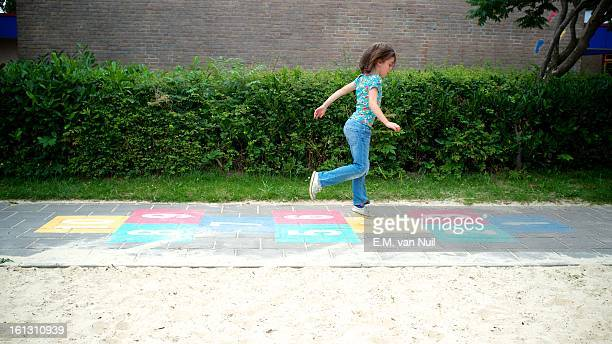 hop on the playground - hopscotch stock pictures, royalty-free photos & images
