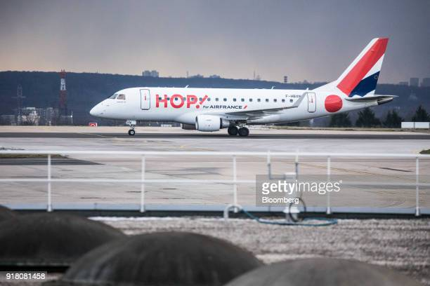 A Hop passenger aircraft operated by Air FranceKLM Group taxis on the runway at Charles de Gaulle airport operated by Aeroports de Paris in Paris...