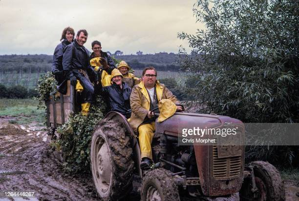Hop pickers returning from the fields riding on Massey Ferguson 35 tractor on a farm near Cranbrook in Kent, United Kingdom, September 1970.