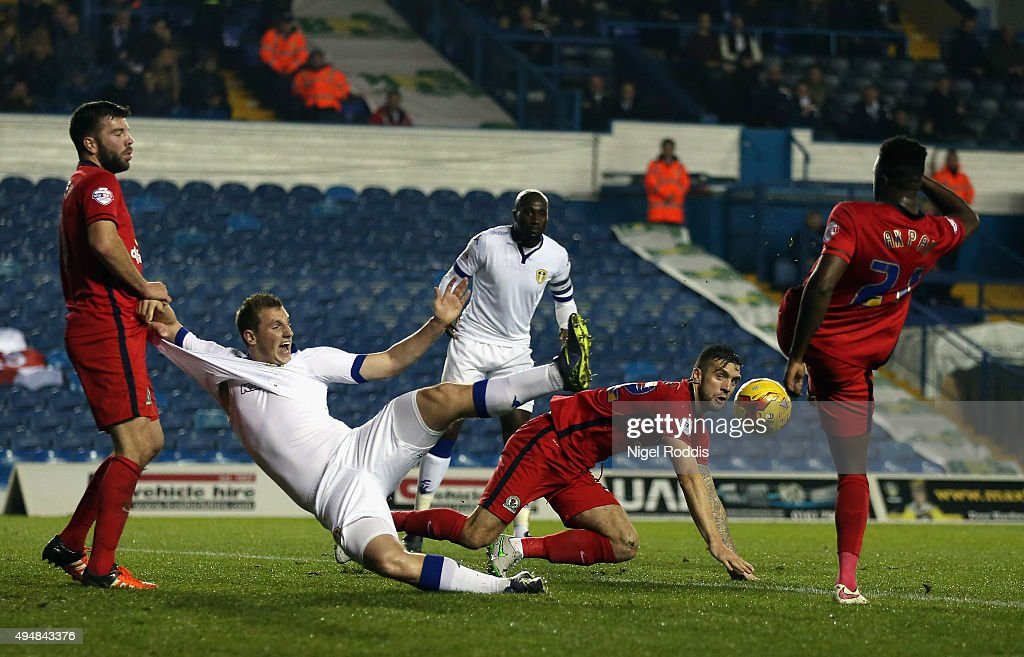 Hope Akpan (R) of Blackburn Rovers clears the ball from Chris Wood (2ndL) of Leeds United during the Sky Bet Championship match between Leeds United and Blackburn Rovers on October 29, 2015 in Leeds, United Kingdom.