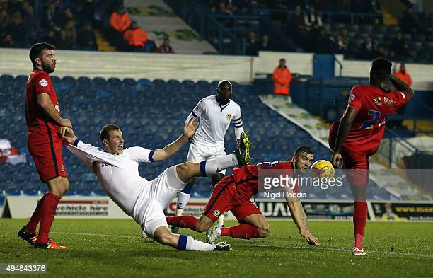 Hope Akpan of Blackburn Rovers clears the ball from Chris Wood of Leeds United during the Sky Bet Championship match between Leeds United and...
