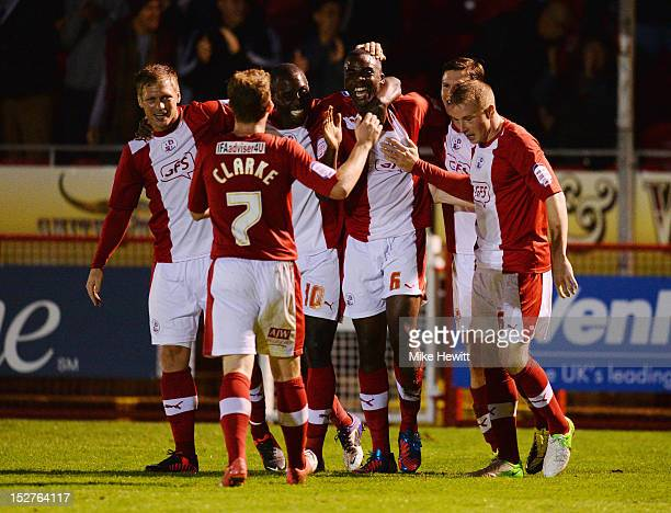 Hope Akpan of Crawley Town celebrates with team mates as he scores their second goal during the Capital One Cup Third Round match between Crawley...
