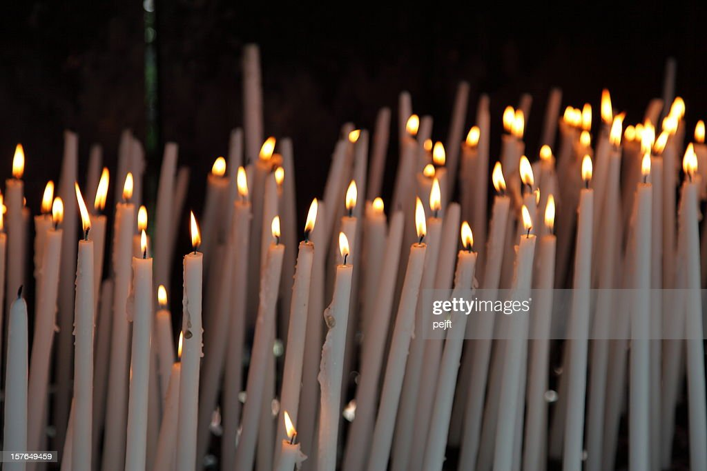 Hope and believe - light a candle in Lourdes. : Stock Photo