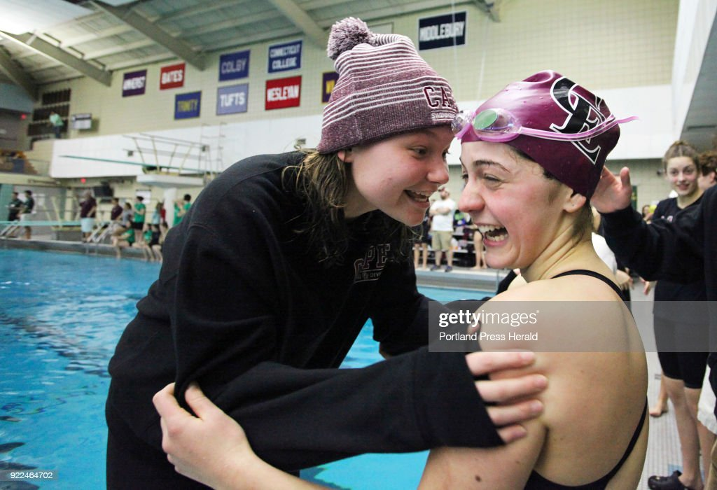 Hope Campbell, left, congratulates Cape teammate Maddie McCormick after she swam the100 yard breastroke at the Maine HIgh School Girls Class B State Swimming and Diving Championships at Bowdoin College.