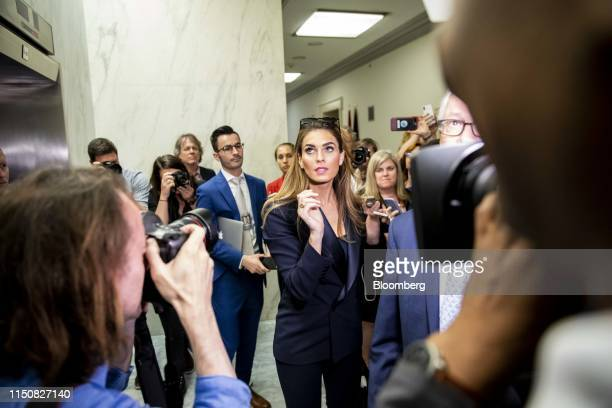 Hope Hicks, former White House communications director, center, leaves following a closed-door interview with the House Judiciary Committee in...